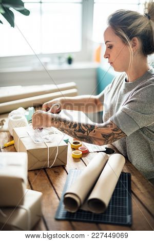 Woman packing parcel box