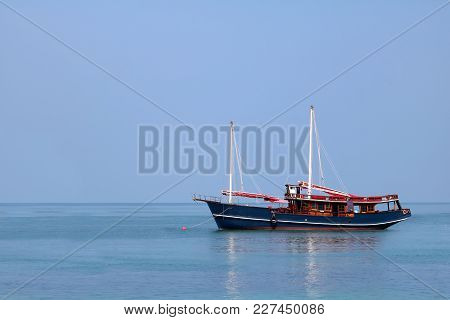 Traditional Wooden Sailboat In The Sea In Thailand