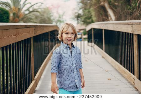 Young Handsome Boy Walking In The Park