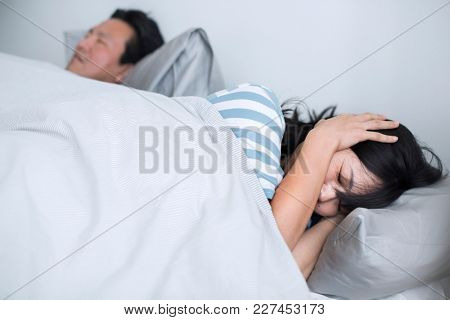Husband disrupting wife's sleep with his loud snoring
