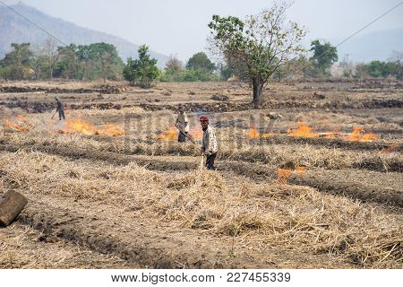 Gia Lai , Vietnam - March 12, 2017: Countryside Field With Fire Made With Dry Rice Straw In Gia Lai,