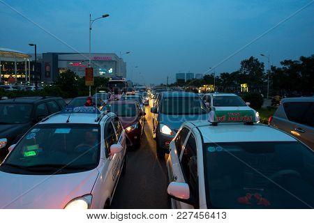 Hanoi, Vietnam - Sep 4, 2016: Cars On Urban Street In Traffic Jam At Twilight In Co Linh Street, Lon