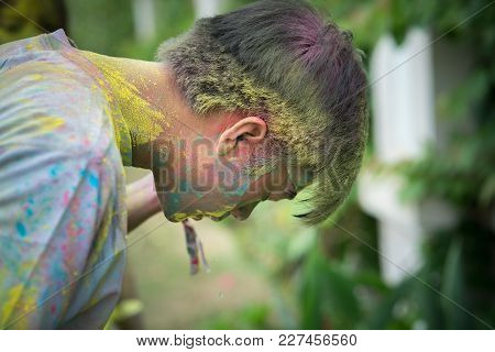 Hanoi, Vietnam - Apr 22, 2017: Runner Head Covered With Colored Powder At Color Me Run Event In Long