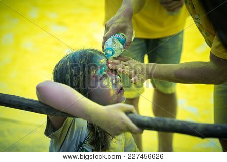 Hanoi, Vietnam - Apr 22, 2017: Children Got Dust In Eye And Getting Clean By Fresh Water At Color Me