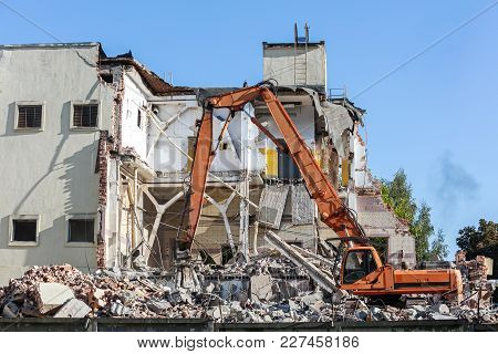 Excavator With Hydraulic Jaws Work At Demolition Site