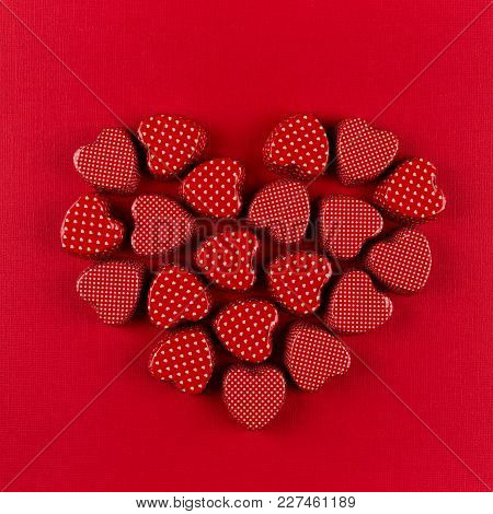 Red Heart Of Small Hearts On Deep Red Paper Background. Valentine Day.