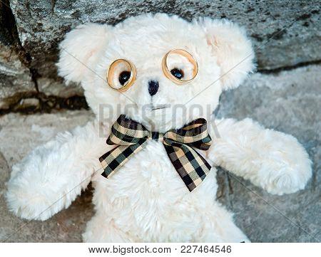Wedding Rings As Glasses Toy Bear. White Bear