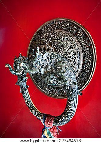 Door Handle In The Form Of A Dragon On Door Of Gompa - Buddhist Monastery. Bodh Gaya, India