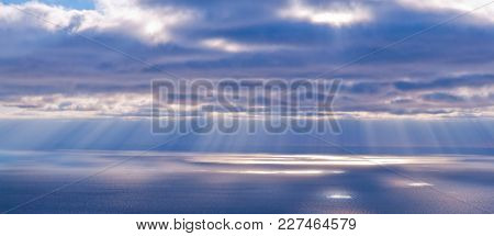 Beautiful Scenery With Clouds And Sunbeams In Blue And Pink Colors