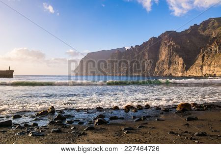 Amazing View Of Beach In Los Gigantes With High Cliffs On The Sunset. Location: Los Gigantes, Teneri