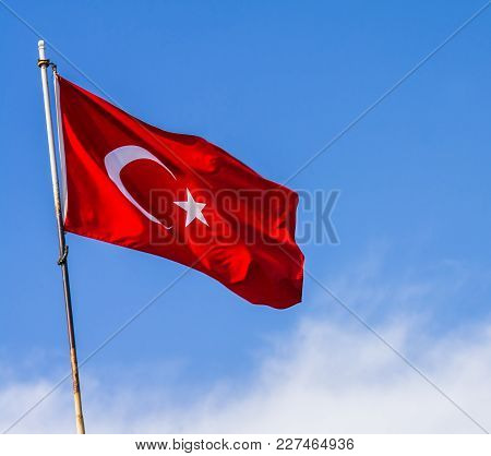 Turkey Flag Waving In The Blue Sky