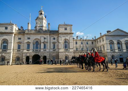 London / Uk - November 17 2017: Red Cavalryman Troop On Strong Black Horse At The Household Cavalry