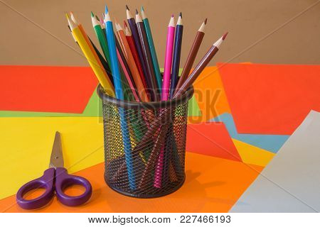 Color Pencil On Colored Paper. Bright Colored Pencils
