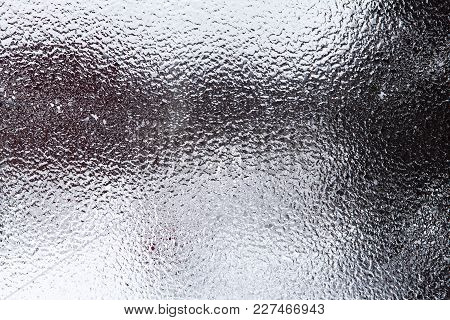 Freezing Rain On A Window. Silhouettes, Shapes Of What´s Outdoors.