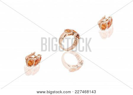 Yellow Gold Precious Earrings Ring With Diamonds On White Isolated Background.