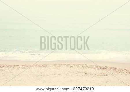Vintage Toned  Beach And Sea.  Tranquility Of Turquoise Water. Pastel Color