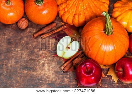 Harvest Or Thanksgiving Background With Pumpkins, Apples And Fallen Leaves On Wooden Background  Wit