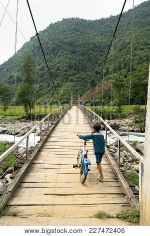 Yen Bai, Vietnam - Sep 18, 2016: Vietnamese Hmong Ethnic Minority Boy Walking On Old Wooden Bridge W