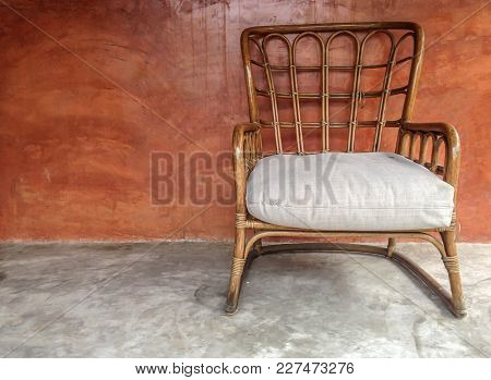 Rattan Chair On Concrete Floor With Brown Wall