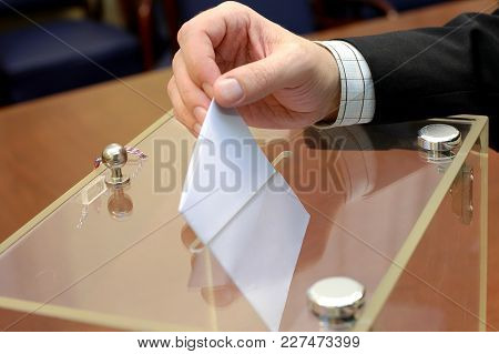 Image Of A Ballot Box And Hand Putting A Blank Ballot Inside,elections, Voting Concept