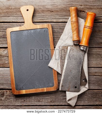 Butcher. Vintage meat knives and blackboard. Top view with space for your recipe or menu