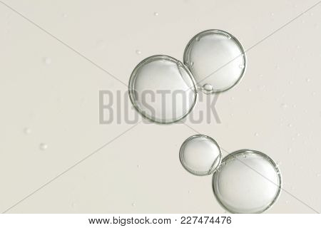 Four Large Air Bubbles Flowing Oaver A Blurred Background
