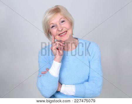 Portrait Of A Smiling Senior Woman. Beautiful Modern Grandmother. Pensioner.