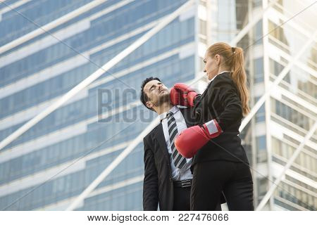 Two Competitive Businessperson And Boxing Gloves Attacking One Another. Concept Fight For Business.