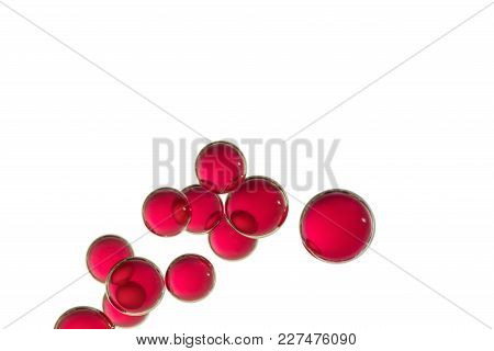 A Group Of Red Air Bubbles Isolated Over A White Background