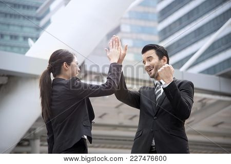 Businessman And Businesswoman Hands High Five Meeting Greeting.
