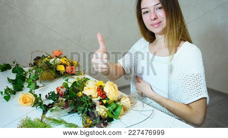 Attractive Girl Corrects Bouquet And Looks At  Camera, Smiling And Posing, Showing Thumbs-up Gesture