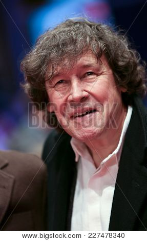 Stephen Rea poses on the red carpet upon arrival for the premiere of the film 'Black 47' during the 68th Berlinale film festival on February 16, 2018 in Berlin.
