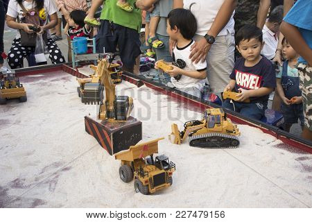 Thai Children And Parent Travel And Playing Radio Controller Toy Construction Machinery In Bang Mod