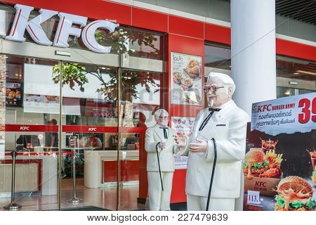 Bangkok ,thailand- August 22 ,2017: Colonel Harland Sanders Statue Standing In Front Of Kentacky Fri