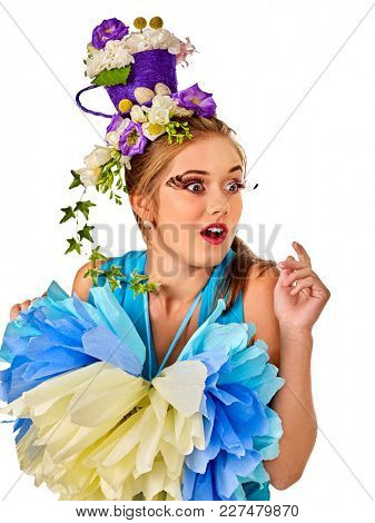 Easter girl holding bunny and eggs. Delight woman with holiday hairstyle and make up holding rabbit in basket with flowers. Adults at festival on isolated. Spring fashion.