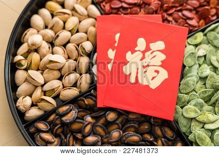 Lunar new year chinese snack tray with red packet word means luck