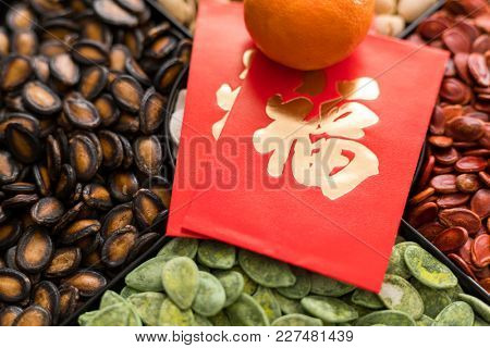 Traditional lunar new year snack tray with red packet word mean luck
