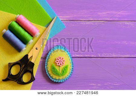 Small Patchwork Easter Egg Decor, Colored Thread Set, Scissors, Felt Sheets On A Purple Wooden Backg