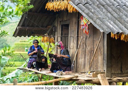 Yen Bai, Vietnam - Sep 17, 2016: Hmong Ethnic Minority Women Sewing Clothing At Their House