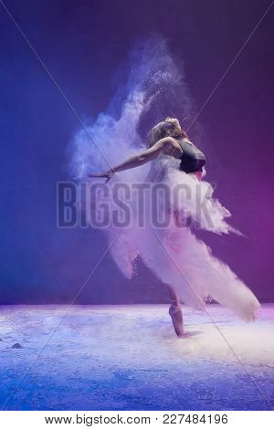 Woman In Undrewear And Pointe Shoes Jumping Gracefully In A White Dust Cloud And Color Light Profile
