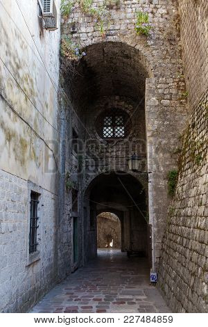 Stone Old Corridor With Round Window In The Old Town Of Kotor
