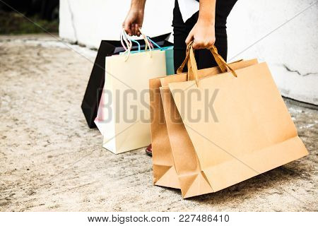 Female Lady Carrying Colorful Shopping Bags Concept. Wrong Posture, Back Bending, Bad Ergonomics