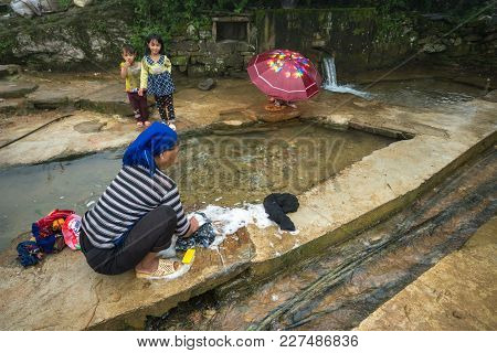 Lao Cai, Vietnam - Sep 7, 2017: Ethnic Minority Woman Washing Clothes At Water Supply In Y Ty, Bat X