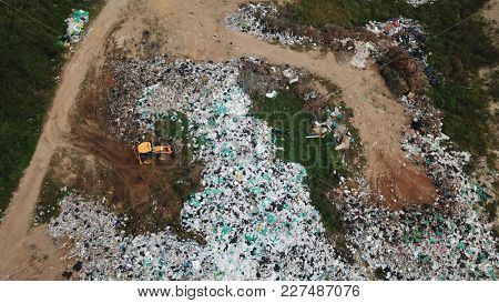 Landfill. Plastic rubbish - bags and bottles, dumped in tip causing environmental pollution problem