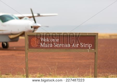 Masai Mara, Kenya - 29th July 2017: The Mara Serena air strip. Small planes land and take off from here bringing tourists in and out for safaris on domestic flights connecting with Nairobi.