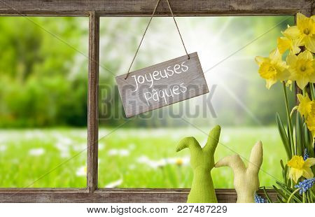 Sign With French Text Joyeuses Paques Means Happy Easter. Window Frame With View To Beautiful Sunny