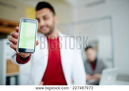 Contemporary man showing his smartphone with important notification inside