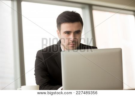 Portrait Of Handsome Millennial Businessman Working On Laptop, Successful Ceo Reading Business News