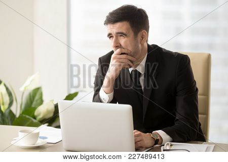 Tired Businessman Covering His Mouth With Hand When Yawning At Desk In Office. Office Worker Feeling