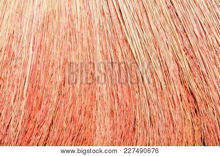 Texture Of A Broom. Broom Close-up. Red Broom